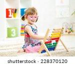 kid girl with eyeglasses... | Shutterstock . vector #228370120