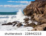Waves Crashing Into Rocks