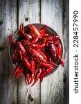 crayfish on wooden background | Shutterstock . vector #228457990