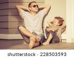 dad and son playing near a... | Shutterstock . vector #228503593