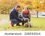 Stock photo care animals family season and people concept smiling couple with dog in autumn park 228533314