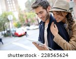 couple in town connected on...   Shutterstock . vector #228565624