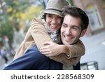 man giving piggyback ride to... | Shutterstock . vector #228568309