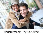 man giving piggyback ride to... | Shutterstock . vector #228570490