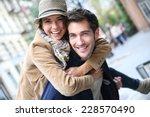 man giving piggyback ride to...   Shutterstock . vector #228570490