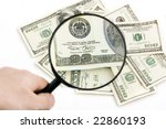 Dollars under zoom, Inflation has reduced cost of dollar - stock photo