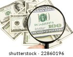 One hundred Dollars under zoom - stock photo