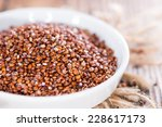 red quinoa in a bowl on wooden... | Shutterstock . vector #228617173