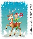 elf riding reindeer with... | Shutterstock . vector #228617230