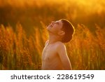 happy boy stands among the high ... | Shutterstock . vector #228619549