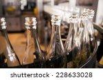 bottles on the conveyor belt   Shutterstock . vector #228633028