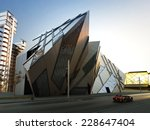 Futuristic city block. Collection of modern abstract buildings and custom vehicle. - stock photo