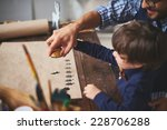 young man teaching his son how... | Shutterstock . vector #228706288