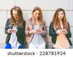 girls typing on mobile phones  ...   Shutterstock . vector #228781924