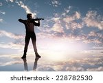 silhouette of man playing... | Shutterstock . vector #228782530