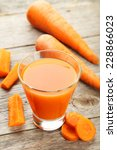 glass of carrot juice on grey... | Shutterstock . vector #228866023