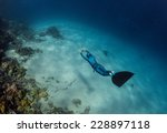 lady free diver swimming over... | Shutterstock . vector #228897118