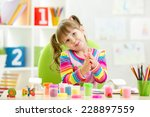 kid girl drawing and making by... | Shutterstock . vector #228897559