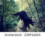 scared young woman running... | Shutterstock . vector #228916603
