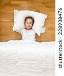 little smiling girl lying on... | Shutterstock . vector #228938476