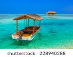 Boat And Bungalow On Maldives...