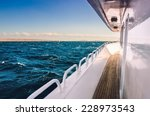 Small photo of White yacht in the red sea at sunset. Beautiful summer seascape. Creative toning effect