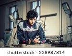 young craftsman in uniform...   Shutterstock . vector #228987814