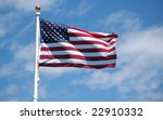 american flag flying against a... | Shutterstock . vector #22910332