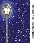lantern  in snowfall on blue... | Shutterstock .eps vector #229106086