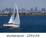 A Sailboat Speeds Along In San...