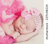 sleeping newborn girl in pink... | Shutterstock . vector #229148224