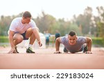 young man exercising with... | Shutterstock . vector #229183024