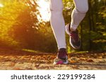 fitness girl running at sunset... | Shutterstock . vector #229199284