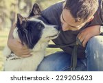 man with his dog playing... | Shutterstock . vector #229205623