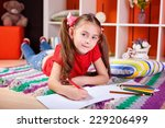girl drawing with pencils at... | Shutterstock . vector #229206499