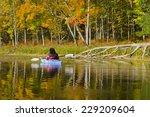 Woman Enjoys The Autumn Beauty...