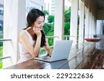asian woman happily using a... | Shutterstock . vector #229222636
