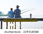 Boy And His Father Fishing...