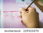 test paper and pencil | Shutterstock . vector #229323370