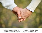 Hands Holding Together On A...