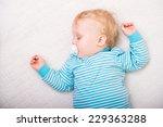 sleeping baby on white blanket | Shutterstock . vector #229363288