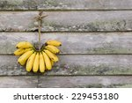 Banana Hanging On Old Wooden...