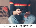 a young man is sitting on a... | Shutterstock . vector #229476190
