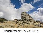 The Sphinx of Bucegi, in the Bucegi Plateau - Bucegi Natural Park, Carpathian Mountains, Romania - in a warm summer day.