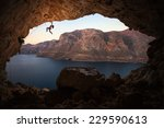 Female Rock Climber On A Cliff...