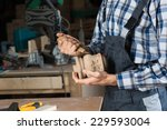 close up carpenter's hands that ... | Shutterstock . vector #229593004