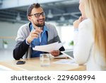 smiling businessman with papers ... | Shutterstock . vector #229608994