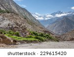 Small photo of Lubra village in Mustang, Himalays, Nepal. Tibetan landscape with traditional houses and mountains. Landscape of a small tibetan village among the huge Himalayas mountains.