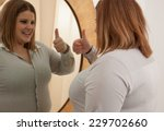 woman looking and accepting... | Shutterstock . vector #229702660