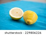 two halves of lemons on a table. | Shutterstock . vector #229806226